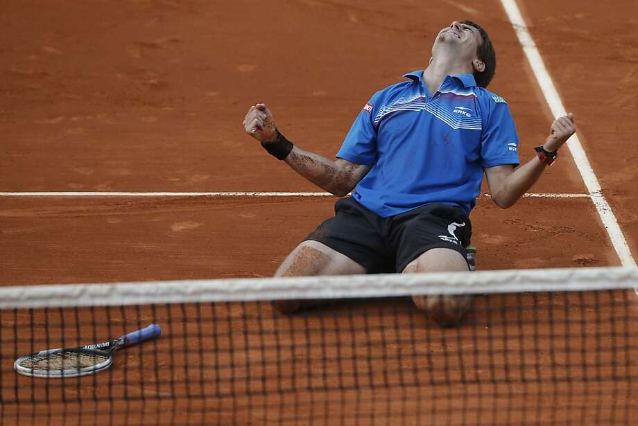 Tommy Robredo of Spain celebrates defeating Gael Monfils of France in their third round match at the French Open tennis tournament, at Roland Garros stadium in Paris, Friday, May 31, 2013. Robredo won in five sets 2-6, 6-7, 6-2, 7-6, 6-2. (AP Photo/Michel Spingler) Photo: Michel Spingler, Associated Press