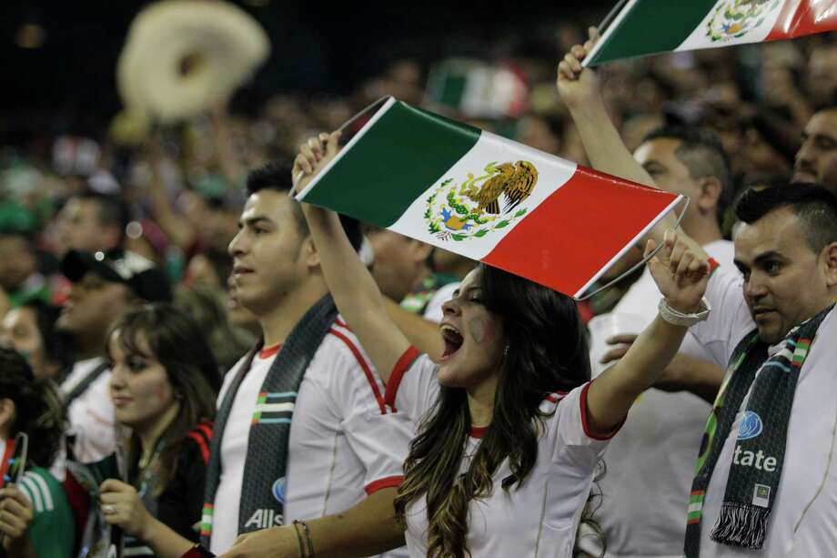 Fans cheers on team during the Mexico and Nigeria soccer match at Reliant Stadium Friday, May 31, 2013, in Houston. Photo: Melissa Phillip, Houston Chronicle / © 2013  Houston Chronicle