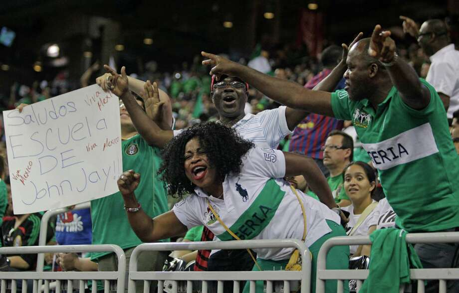 Fans cheer after Nigeria team goal against Mexico  during the first half of soccer match at Reliant Stadium Friday, May 31, 2013, in Houston. Photo: Melissa Phillip, Houston Chronicle / © 2013  Houston Chronicle