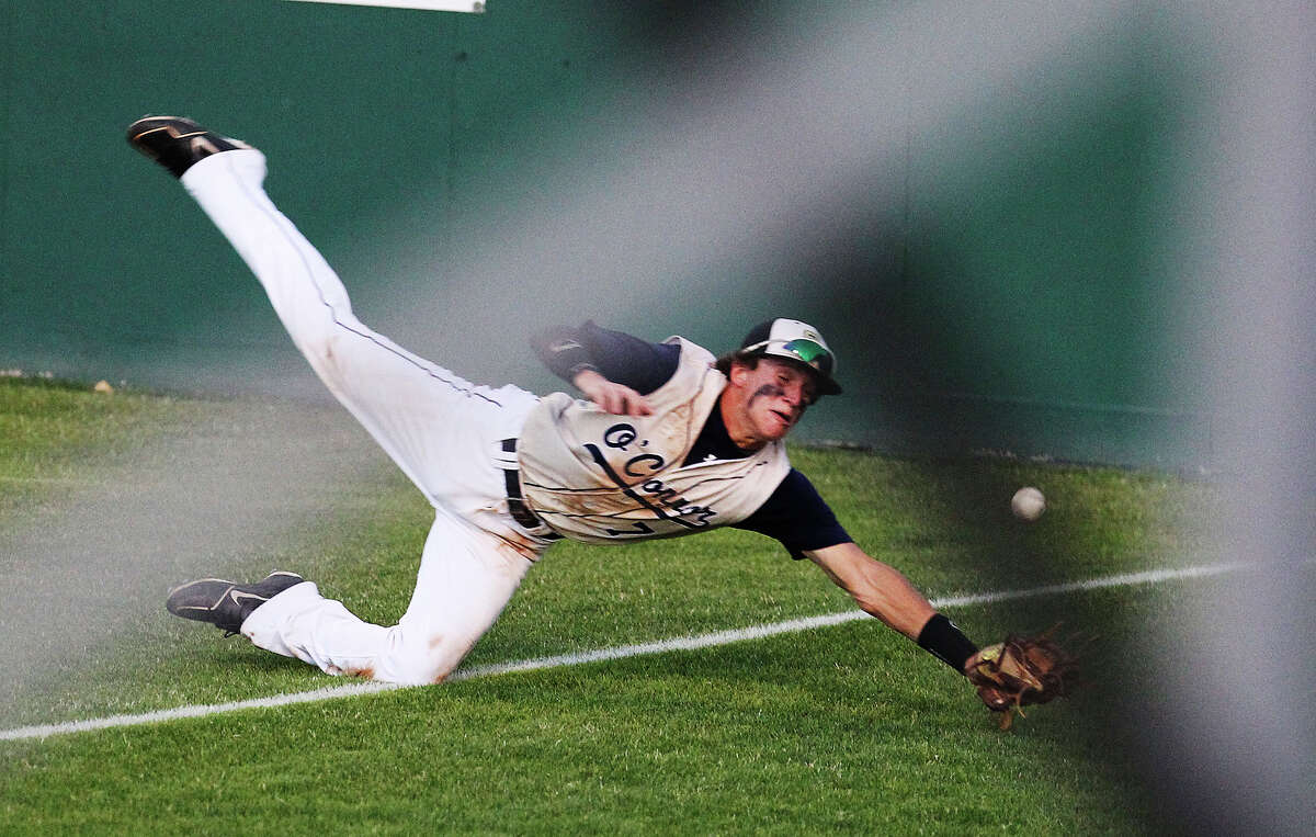 O'Connor's Zachary Galm dives in an attempt to make a play on a foul ball in far right field against Eagle Pass in Class 5A baseball playoff game at Blossom Athletic Center on Friday, May 31, 2013. The Panthers defeated Eagle Pass, 3-2, and moved to the state tournament.