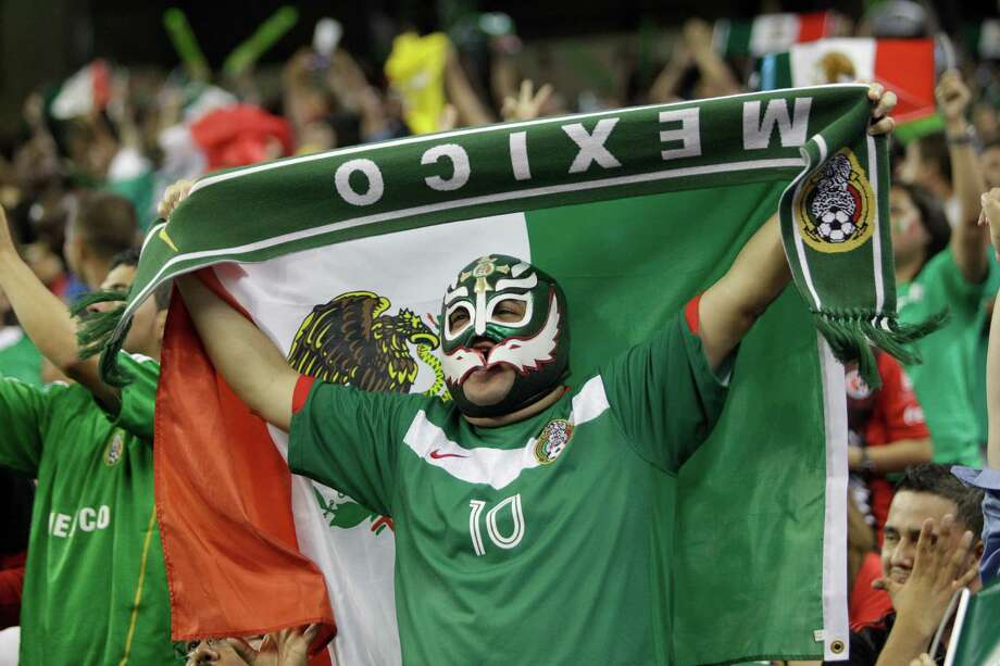 A fan cheers  on his team during the Mexico and Nigeria soccer match at Reliant Stadium Friday, May 31, 2013, in Houston. Photo: Melissa Phillip, Houston Chronicle / © 2013  Houston Chronicle