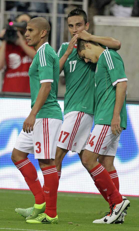 Mexico player Javier Hernandez, right, celebrates his goal with teammates Carlos Salcido, left, and Jesus Zavala, center,  during the second half of game against Nigeria at Reliant Stadium Friday, May 31, 2013, in Houston. Photo: Melissa Phillip, Houston Chronicle / © 2013  Houston Chronicle
