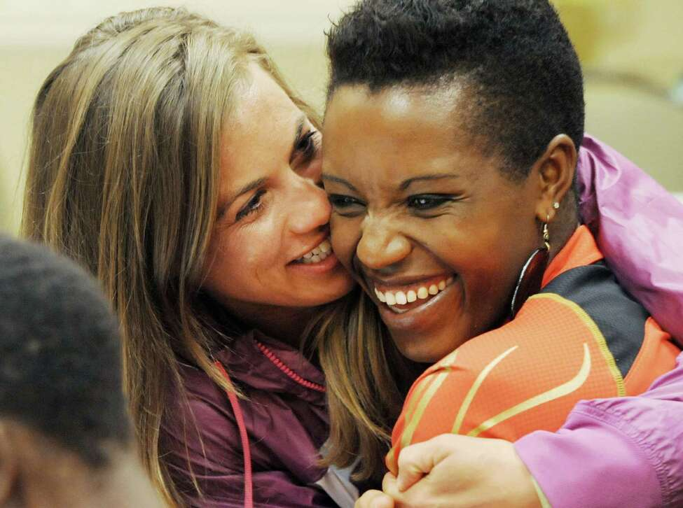 USA's elite runner Michelle Frey gives Burundi's elite runner Diane Nukuri Johnson a hug while sharing a laugh during the Freihofer's Run for Women news conference held at the 74 State Hotel on Friday, May 31, 2013 in Albany, N.Y. (Lori Van Buren / Times Union)