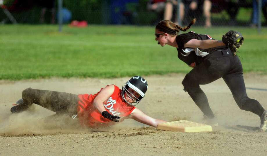 Guilderland's Doris Kane, left, tries to steal second and gets tagged out by Bethlehem's Erin O'Donn