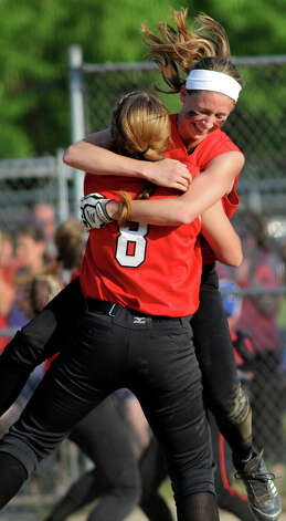 Guilderland's Jenna Cubello, right, hugs teammate Mallory Harrigan as they celebrate their win over Bethlehem in the Class AA softball final on Friday, May 31, 2013, at Clifton Common in Clifton Park, N.Y. (Cindy Schultz / Times Union) Photo: Cindy Schultz / 00022632A