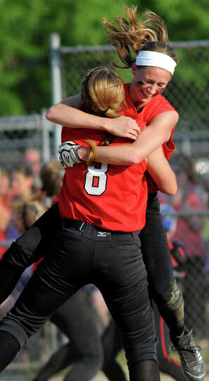 Guilderland's Jenna Cubello, right, hugs teammate Mallory Harrigan as they celebrate their win over