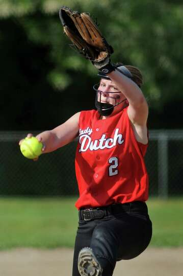Guilderland's Taylor Tewksbury winds up a pitch during their Class AA softball final against Bethleh