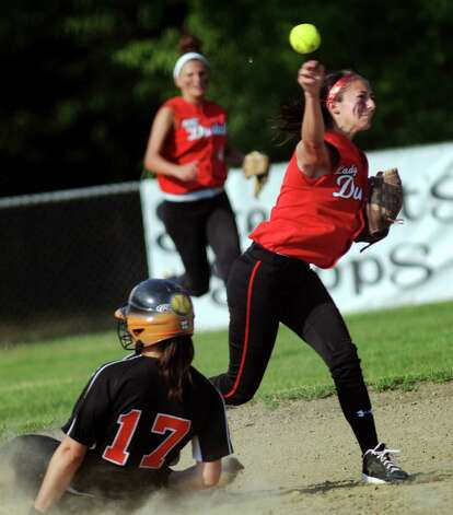 Guilderland's Tori Greco, right, turns the double play after getting out Bethlehem's Erin O'Donnell during their Class AA softball final on Friday, May 31, 2013, at Clifton Common in Clifton Park, N.Y. (Cindy Schultz / Times Union) Photo: Cindy Schultz / 00022632A