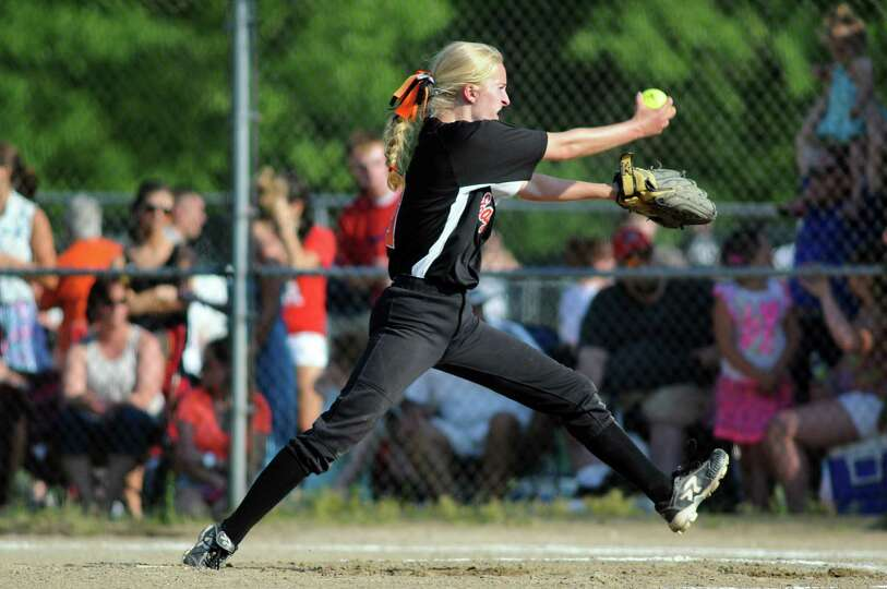 Bethlehem's Emma Downing winds up a pitch during their Class AA softball final against Guilderland o