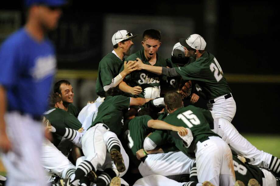 Shenendehowa players pile onto the field as they celebrate their win over Shaker in their Class AA baseball final on Friday, May 31, 2013, at Bruno Stadium in Troy, N.Y. (Cindy Schultz / Times Union) Photo: Cindy Schultz / 00022633A