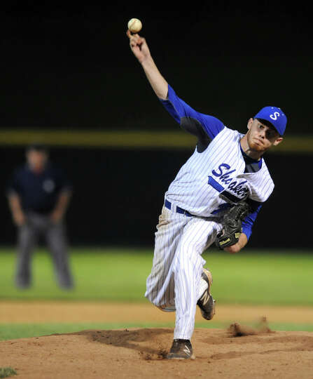 Shaker's Nick Gavin winds up a pitch during their Class AA baseball final against Shenedehowa on Fri