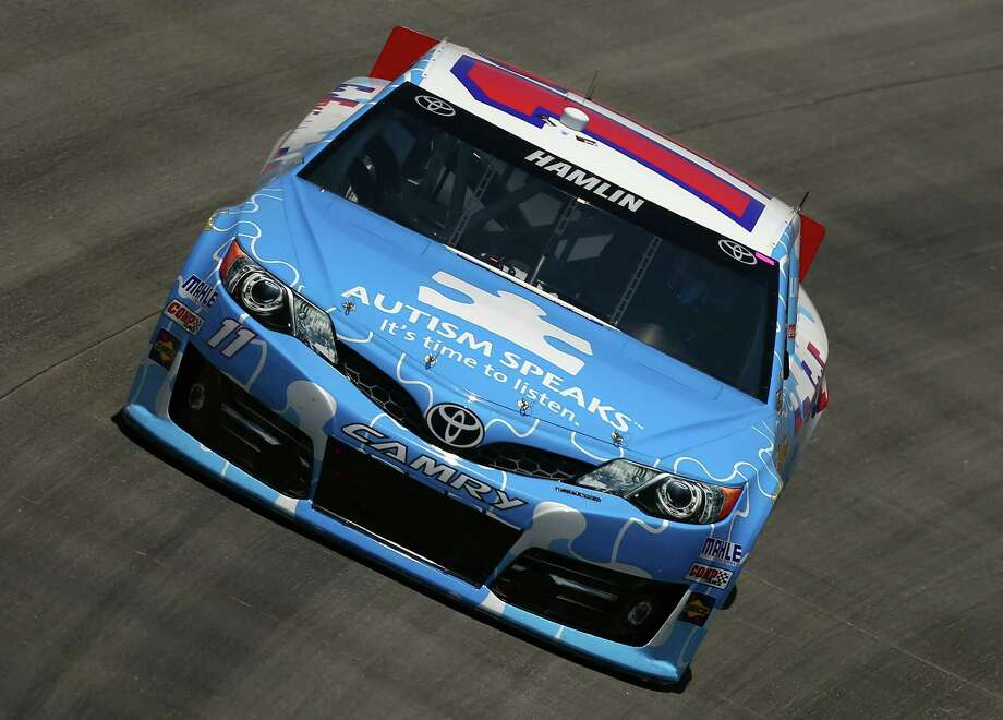 DOVER, DE - MAY 31:  Denny Hamlin, driver of the #11 FedEx Freight/Autism Speaks Toyota, practices for the NASCAR Sprint Cup Series FedEx 400 benefiting Autism Speaks at Dover International Speedway on May 31, 2013 in Dover, Delaware.  (Photo by Tom Pennington/Getty Images) Photo: Tom Pennington