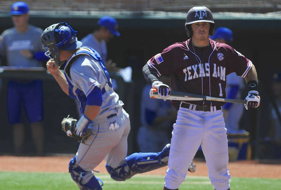 UC Santa Barbara catcher Jackson Morrow celebrates the final out of the Gauchos' 6-4 victory as Blake Allemand and A&M couldn't complete a rally. Photo: Greg Wahl-Stephens / Associated Press