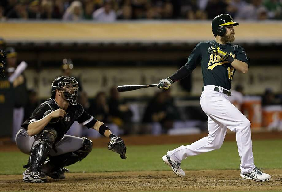 In his first game since May 6, Josh Reddick drives in a run with an eighth-inning double. Photo: Marcio Jose Sanchez, Associated Press