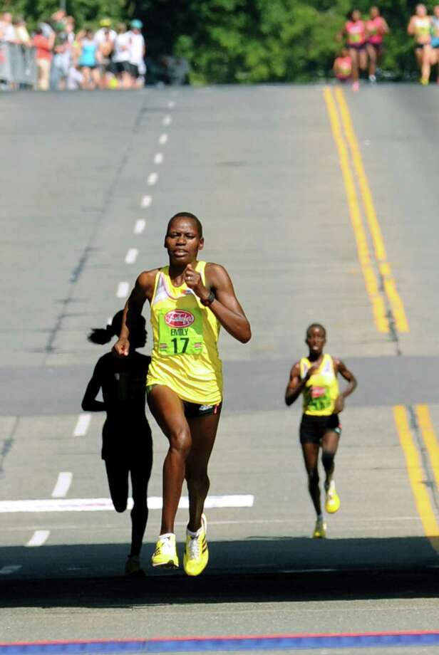 Emily Chebet of Kenya heads to the finish to win the 35th annual Freihofer's Run for Women on Saturday June 1, 2013 in Albany, N.Y.  (Michael P. Farrell/Times Union) Photo: Michael P. Farrell