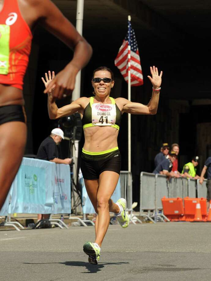 Dorota Gruca of Poland wins in the Masters class during the 35th annual Freihofer's Run for Women on Saturday June 1, 2013 in Albany, N.Y.  (Michael P. Farrell/Times Union) Photo: Michael P. Farrell