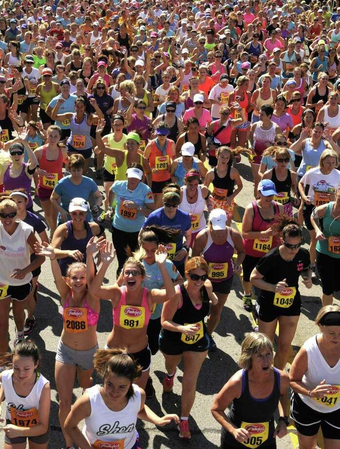 Runners break from the start of the 35th annual Freihofer's Run for Women on Saturday June 1, 2013 in Albany, N.Y.  (Michael P. Farrell/Times Union) Photo: Michael P. Farrell