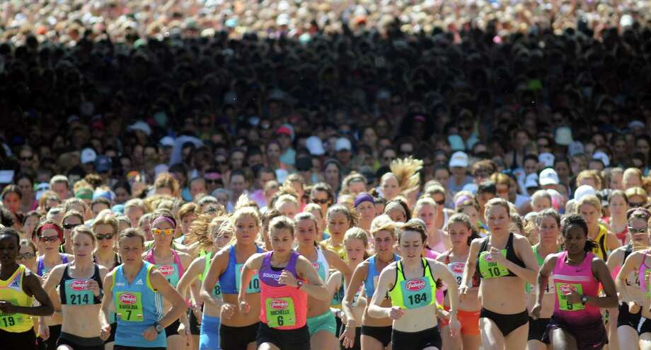 Over 4,000 women take off from the start of the 35th annual Freihofer's Run for Women on Saturday, June 1, 2013, in Albany, N.Y. (Cindy Schultz / Times Union) Photo: Cindy Schultz / 00022653A