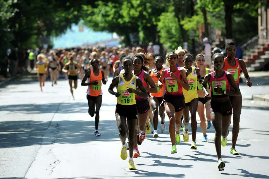 The elite runners lead more than 4,000 women on Madison Avenue during the 35th annual Freihofer's Run for Women on Saturday, June 1, 2013, in Albany, N.Y. (Cindy Schultz / Times Union) Photo: Cindy Schultz / 00022653A