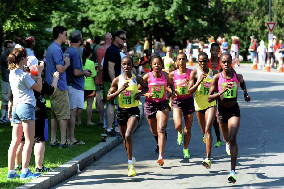 The front runners go through Washington Park during the 35th annual Freihofer's Run for Women on Saturday, June 1, 2013, in Albany, N.Y. (Cindy Schultz / Times Union) Photo: Cindy Schultz / 00022653A