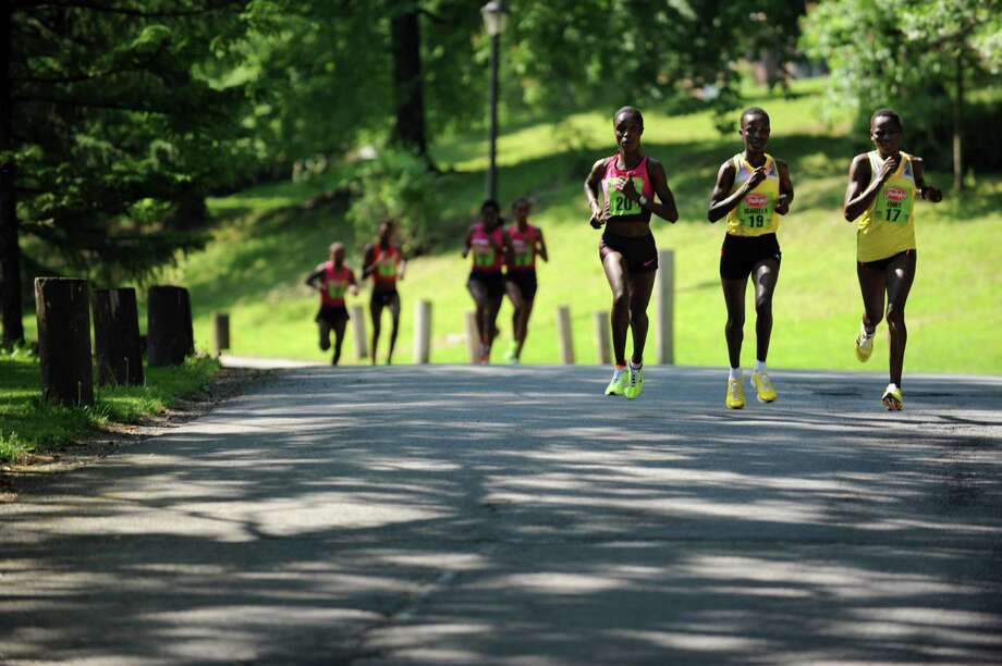 The three front runners Esther Chemtai, left, Isabel Ochichi, center, and Emily Chebet, all of Kenya, go through Washington Park during the 35th annual Freihofer's Run for Women on Saturday, June 1, 2013, in Albany, N.Y. (Cindy Schultz / Times Union) Photo: Cindy Schultz / 00022653A