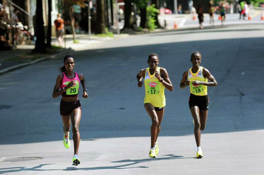 The three front runners Esther Chemtai, left, Emily Chebet, center, and Isabel Ochichi, all of Kenya, during the 35th annual Freihofer's Run for Women on Saturday, June 1, 2013, in Albany, N.Y. (Cindy Schultz / Times Union) Photo: Cindy Schultz / 00022653A