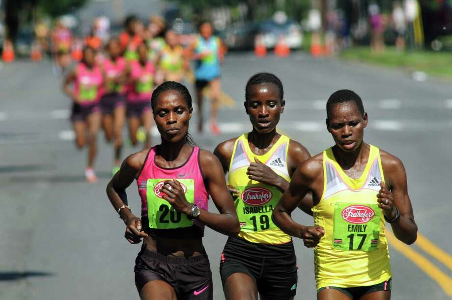 The three front runners Esther Chemtai, left, Isabel Ochichi, center, and Emily Chebet, all of Kenya, during the 35th annual Freihofer's Run for Women on Saturday, June 1, 2013, in Albany, N.Y. (Cindy Schultz / Times Union) Photo: Cindy Schultz / 00022653A