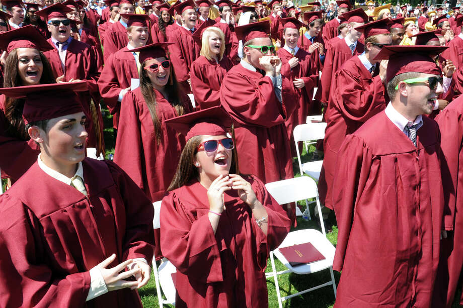 Graduates sing a cheer during graduation for the St. Joseph High School Class of 2013, in Trumbull, Conn., June 1st, 2013 Photo: Ned Gerard / Connecticut Post