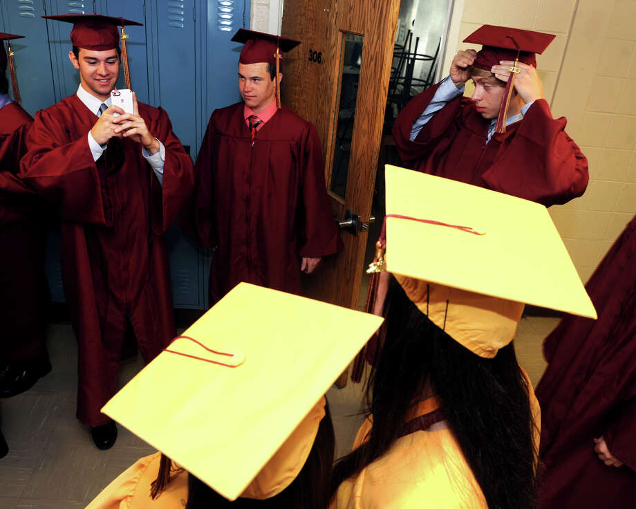 Graduates take pictures as they line up in the hall prior to graduation for the St. Joseph High School Class of 2013, in Trumbull, Conn., June 1st, 2013 Photo: Ned Gerard / Connecticut Post