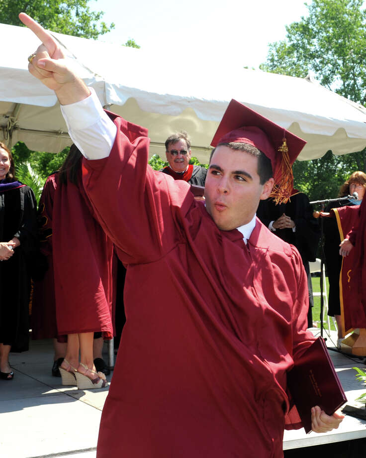 Adam Laracca, of Trumbull, points to the crowd after receiving his diploma during graduation for the St. Joseph High School Class of 2013, in Trumbull, Conn., June 1st, 2013 Photo: Ned Gerard / Connecticut Post