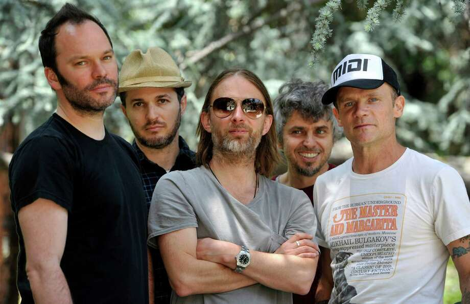 This May 22, 2013 photo shows members of Atoms For Peace , from left, Nigel Godrich, Joey Waronker, Thom Yorke, Mauro Refosco and Flea posing for a portrait in Los Angeles. The band's 27-date tour begins in July in Europe and will reach the US in September before ending in Japan. (Photo by Chris Pizzello/Invision/AP) Photo: Chris Pizzello