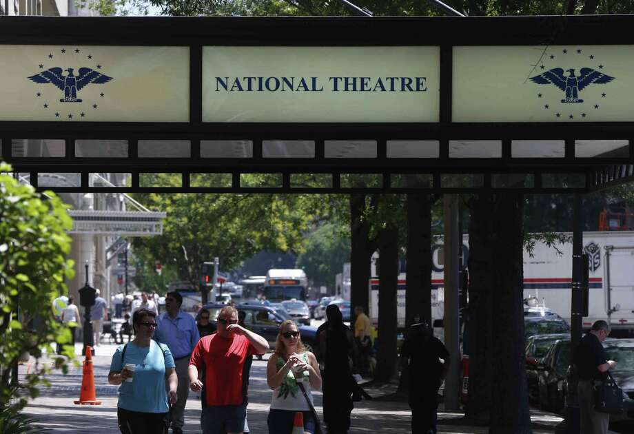 """The National Theater is seen in Washington, Friday, May 31, 2013. The oldest continuously operating theater in the nation's capital, once a regular stop for top performers and shows, is getting a fresh start after struggling for years. A new season of Broadway shows announced this week at the National Theatre includes its first world premiere of a new musical bound for Broadway in two decades with """"If/Then"""" starring Idina Menzel. The season also includes the return of """"West Side Story,"""" which got its start at the National in the 1950s and the Washington premiere of """"American Idiot"""" from the music group Green Day.(AP Photo/Charles Dharapak) Photo: Charles Dharapak"""