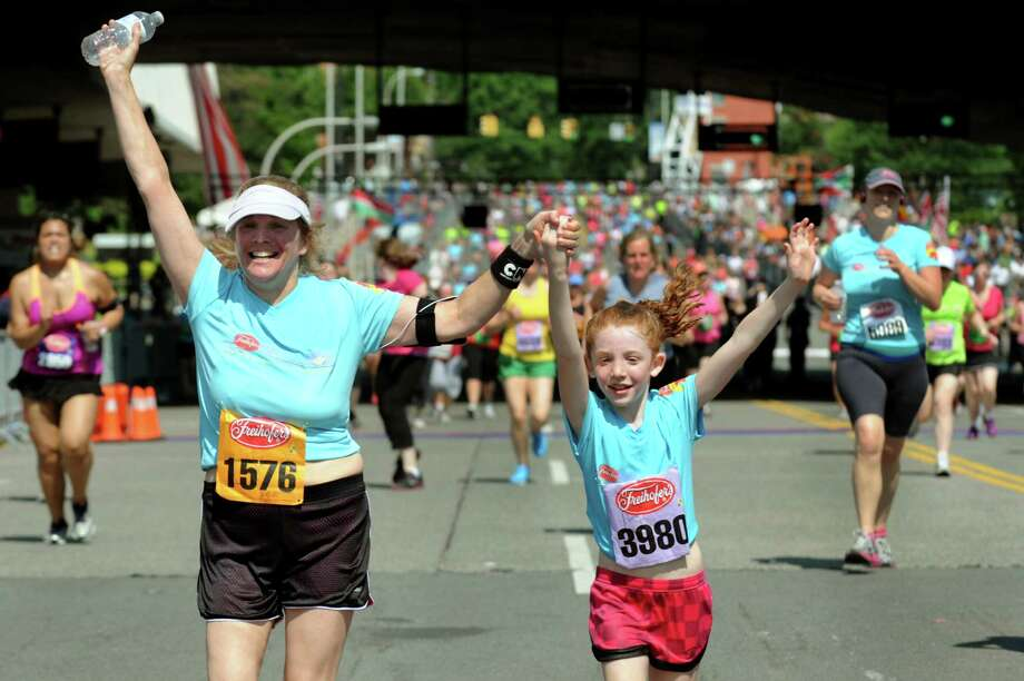 Robyn Easton of Delmar, left, and her daughter Emily Easton, 8, cross the finish line together during the 35th annual Freihofer's Run for Women on Saturday, June 1, 2013, in Albany, N.Y. (Cindy Schultz / Times Union) Photo: Cindy Schultz / 00022653A