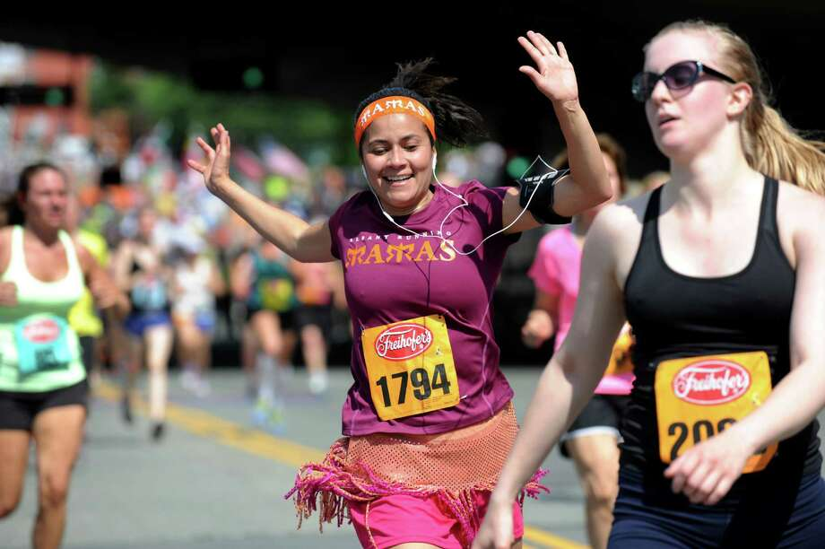 Runners celebrate at the finish line during the 35th annual Freihofer's Run for Women on Saturday, June 1, 2013, in Albany, N.Y. (Cindy Schultz / Times Union) Photo: Cindy Schultz / 00022653A