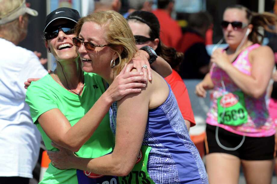 Runners embrace at the finish line during the 35th annual Freihofer's Run for Women on Saturday, June 1, 2013, in Albany, N.Y. (Cindy Schultz / Times Union) Photo: Cindy Schultz / 00022653A