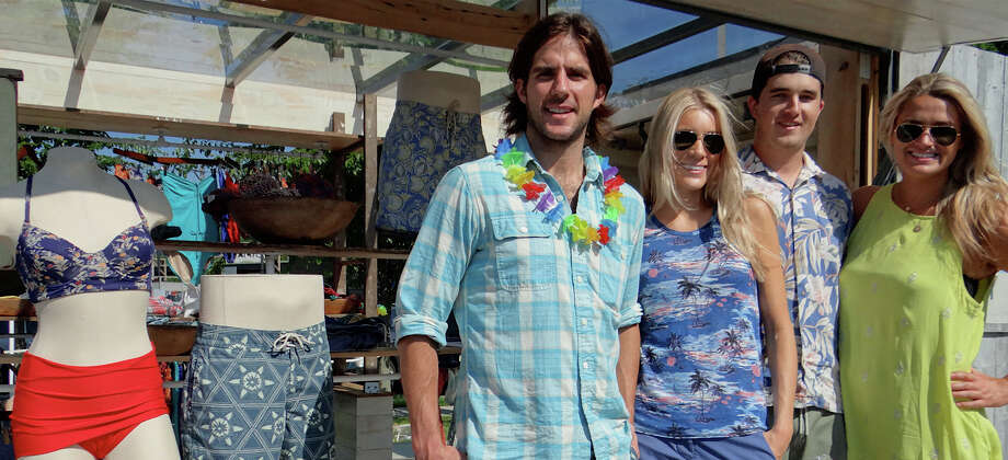 Mike Faherty, Melissa Watson, Petey Metcalf and Brooke Lundy, representing Faherty Brand swimwear, at the new PopShop Market downtown Saturday.  FAIRFIELD CITIZEN, CT 6/1/13 Photo: Mike Lauterborn / Fairfield Citizen contributed