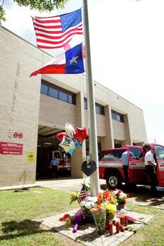 Flags fly at half staff outside Houston Fire Station 68 as a makeshift memorial is placed below to honor the lives of four firefighters Saturday, June 1, 2013, in Houston. A memorial grew outside the fire house honoring the lives of four fallen HFD firefighters, who perished battling a 5-alarm blaze at the Southwest Inn on Friday. Photo: Brett Coomer, Houston Chronicle / © 2013 Houston Chronicle