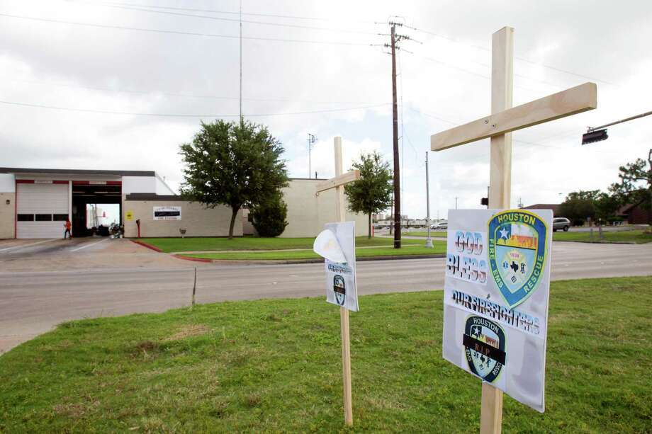 "A pair of crosses with ""God Bless Our Firefighters"" signs on them are seen outside Houston Fire Station 51 on Saturday, June 1, 2013, in Houston. A makeshift memorial grew Saturday, honoring the lives of four HFD firefighters who perished battling a 5-alarm fire at the Southwest Inn on Friday. Photo: Brett Coomer, Houston Chronicle / © 2013 Houston Chronicle"