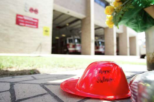A small plastic fire helmet with the name of probationary firefighter Anne Sullivan written on it sits amongst a makeshift memorial outside Houston Fire Station 68 Saturday, June 1, 2013, in Houston. Sullivan, 24, was one of four HFD firefighters to perish battling a 5-alarm fire at the Southwest Inn on Friday. Photo: Brett Coomer, Houston Chronicle / © 2013 Houston Chronicle