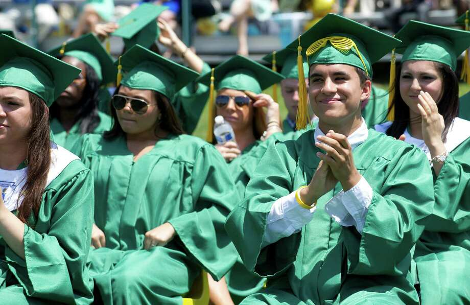 Students applaud during Saturday's commencement ceremony for Trinity High School graduates on June 1, 2013. Photo: Lindsay Perry / Stamford Advocate