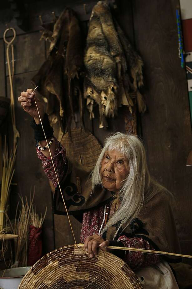 Julia Parker, 84, weaves a basket the traditional way at the replica Indian village behind the museum at Yosemite National Park, a craft she learned from a famed Indian weaver. Photo: Liz Hafalia, The Chronicle