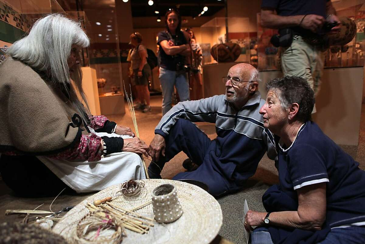 Melvin Mann and his wife Esther Mann (right) listen to Julia Parker as she weaves her basket at the Yosemite museum in Yosemite Valley, Calif., on Wednesday, May 29, 2013. Parker moved to Yosemite at the age of 17 and quickly began learning the craft of basket weaving from her husband?•s grandmother and premier basket weaver, Lucy Telles.