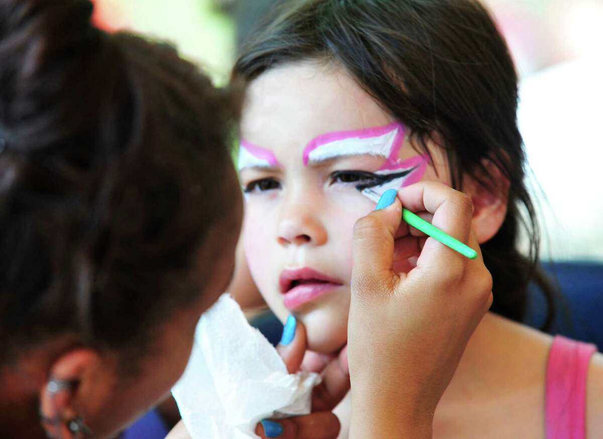 Jailynne Dixon, 6, has her face painted as the fine and applied arts department from all Danbury schools 5th annual arts festival, called The Coda Festival, takes place at Danbury High School in Danbury, Conn. Saturday, June 1, 2013.