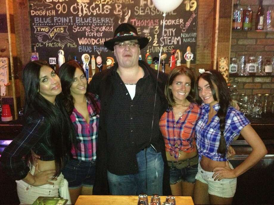 Blues Traveler's front man John Popper hangs out with the staff at Bar Q in Stamford after performing at The Greenwich Town Party last Saturday. Photo: Contributed Photo