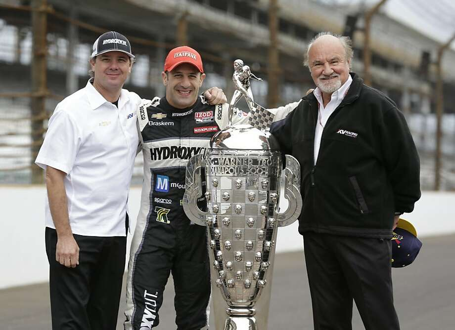 Co-owners Kevin Kalkhoven (right) and Jimmy Vasser join driver Tony Kanaan after the team captured its first win at the Indianapolis 500 last Monday. Kalkhoven lives in Alamo. Photo: Michael Conroy, Associated Press