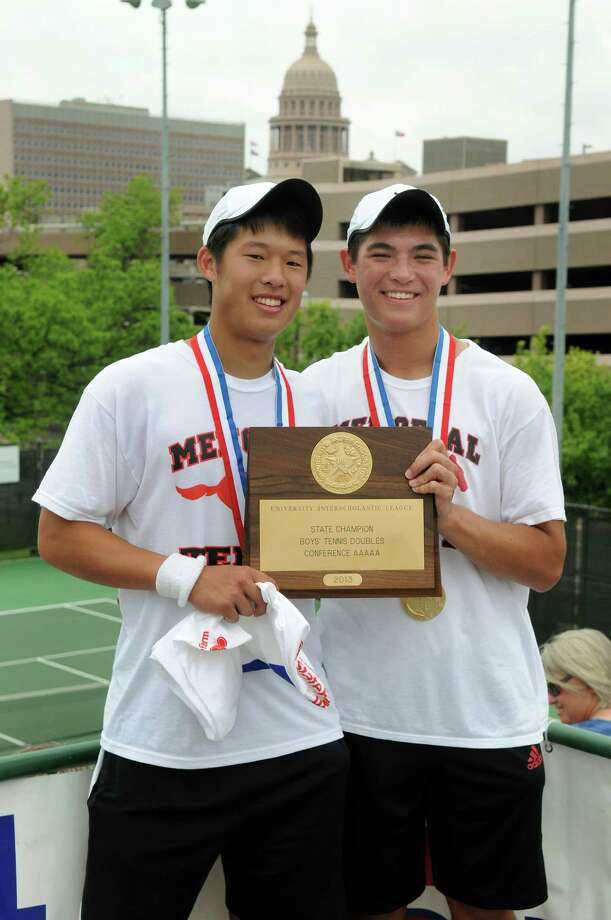 Memorial seniors William Jou, left, and Grant Reichmann show off their Class5A boys doubles trophy after winning the state title in April. Photo: Jerry Baker, Freelance / Freelance