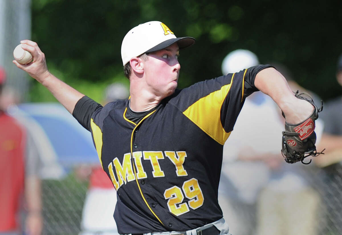 Amity pitcher Michael Concato throws during the Class LL baseball quarterfinal game between Greenwich High School and Amity High School at Greenwich, June 1, 2013. Amity defeated Greenwich 6-0 as Concato threw a no hitter.