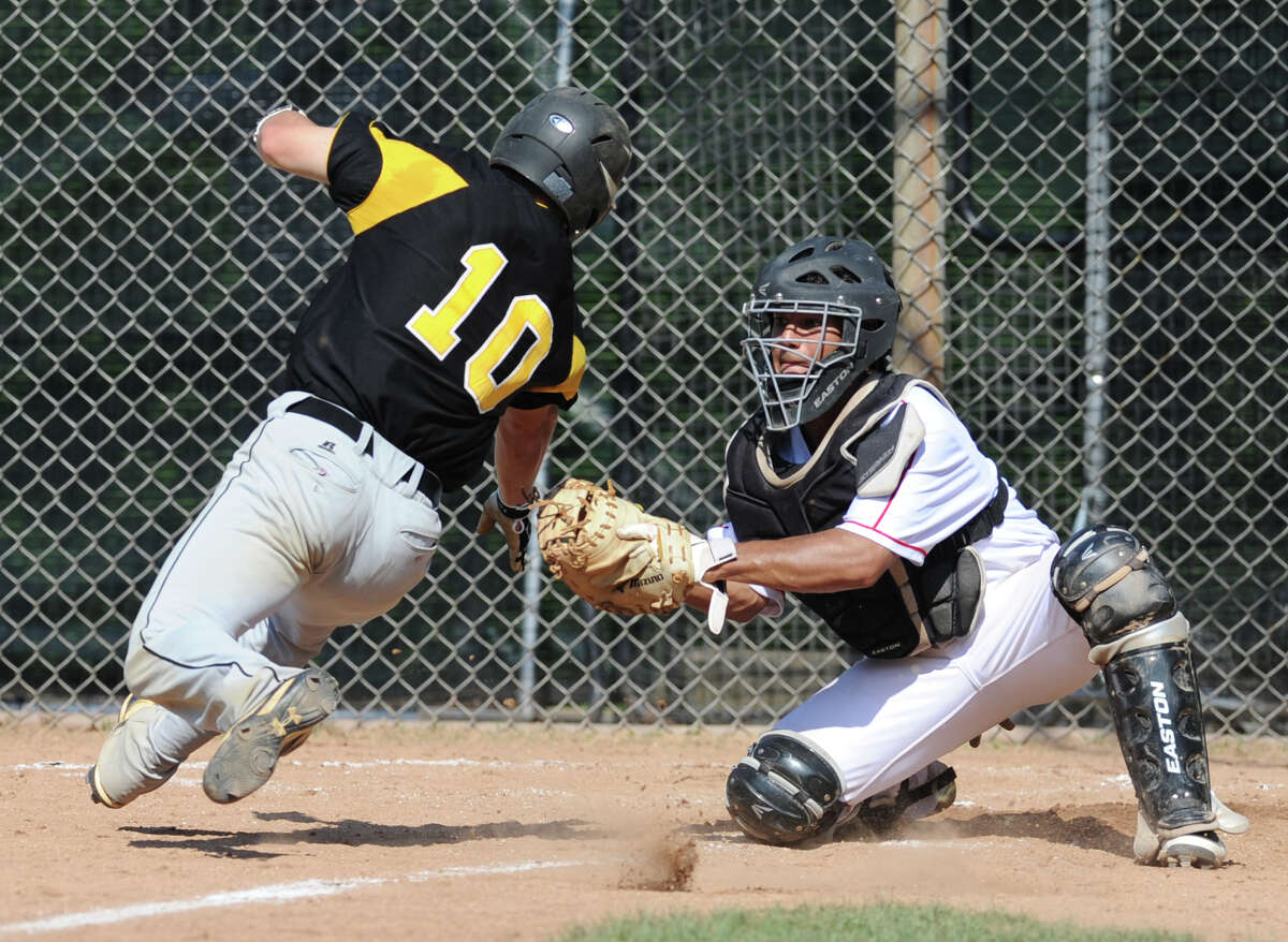 Greenwich catcher Jonathan Dreher, right, appears to miss the tag on Keith Klebart (# 10) of Amity who was called out at the plate in the top of the third inning of the Class LL baseball quarterfinal game between Greenwich High School and Amity High School at Greenwich, June 1, 2013. Amity defeated Greenwich 6-0 as Amity pitcher Michael Concato threw a no hitter.