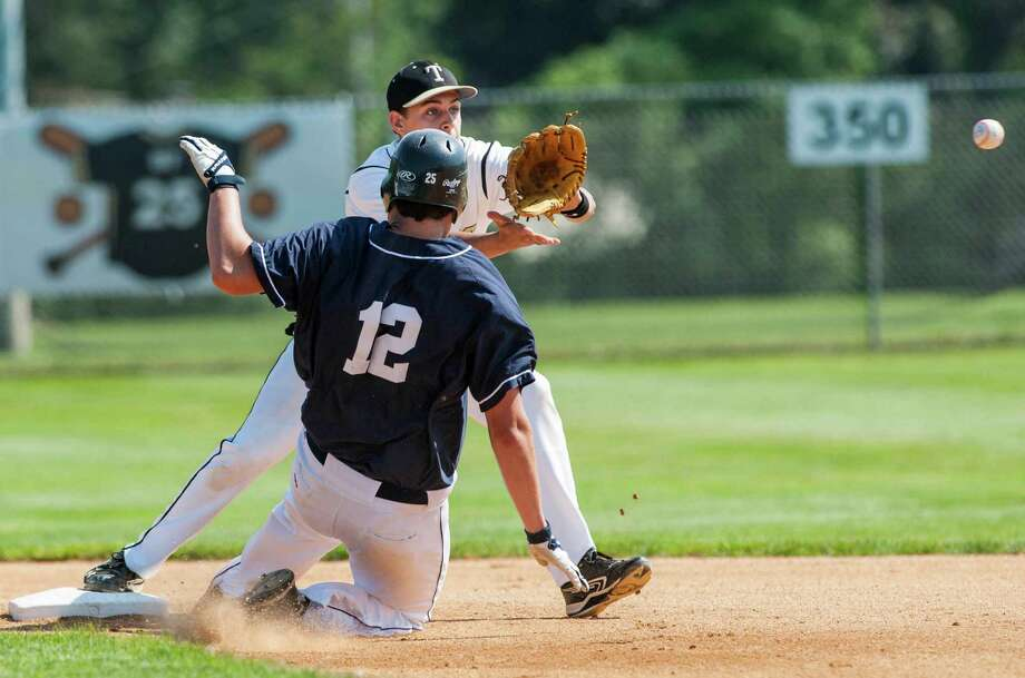 Staples high school's Bryan Porter slides into second base as Trumbull high school shortstop, Luke Waldek, gets a throw to try to complete a double play in a CIAC class LL quarterfinal baseball game played at Trumbull high school, Trumbull, CT on Saturday, June 1st, 2013. Photo: Mark Conrad / Connecticut Post Freelance