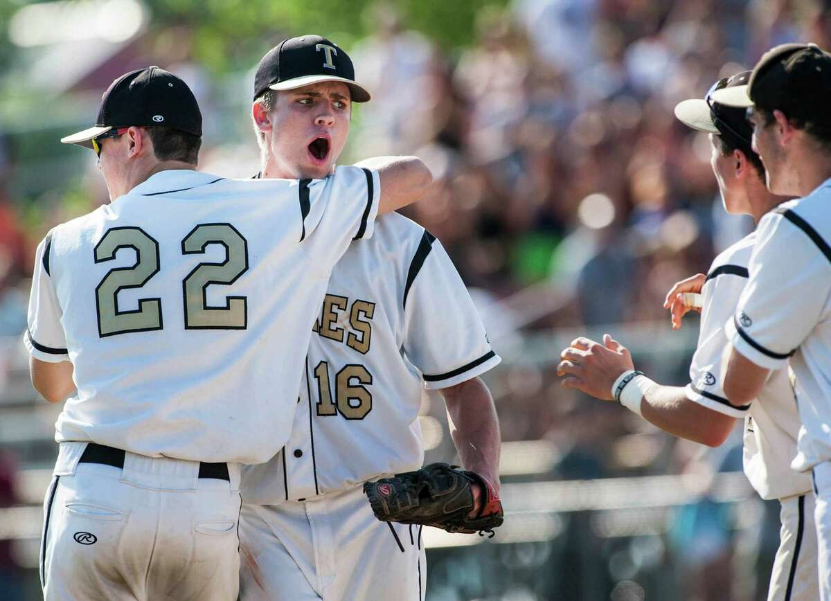 Trumbull high school's Liam Moore comes out to the mound to congratulate pitcher, Gerard Spiegel, after defeating Staples high school in a CIAC class LL quarterfinal baseball game played at Trumbull high school, Trumbull, CT on Saturday, June 1st, 2013.